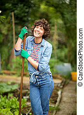 female gardener standing in garden