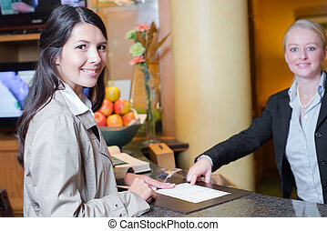 Smiling female guest in a hotel lobby