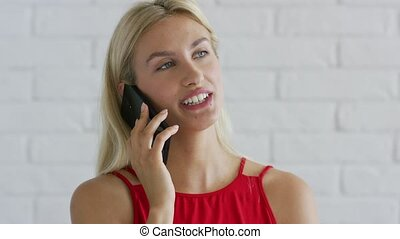Smiling female having phone conversation