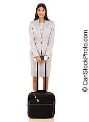female indian business traveller with luggage bag