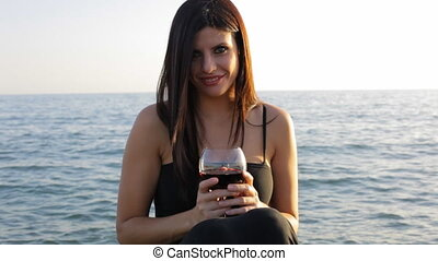 Smiling female model with wine