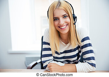 Smiling female operator with headset