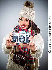 Smiling female photographer with a