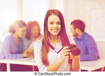 smiling female photographer with photocamera