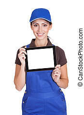 Smiling Female Plumber Holding Digital Tablet