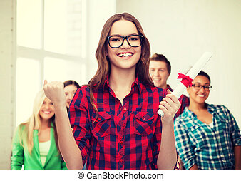 smiling female student in eyeglasses with diploma