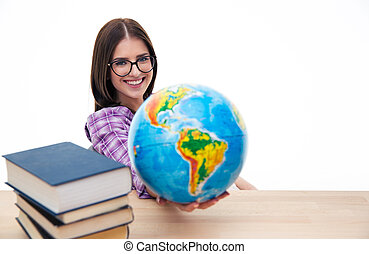 Smiling female student sitting with globe