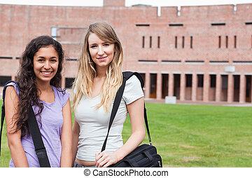 Smiling female students posing