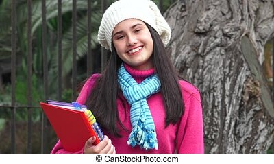 Smiling Female Teen Student Wearing Sweater Cold Weather