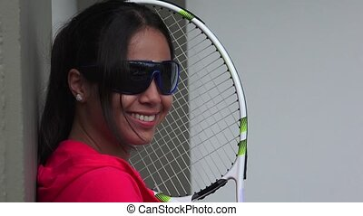 Smiling Female Tennis Player Wearing Sunglasses