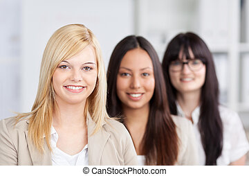 female trainees standing in the office