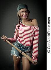 Smiling female with baseball bat