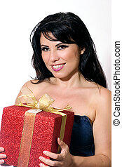 Smiling female with gift box tied with gold ribbon