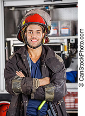 Smiling Firefighter Standing Arms Crossed