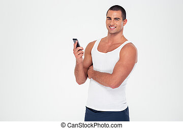 Smiling fitness man holding smartphone