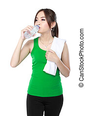 smiling fitness woman drinking water