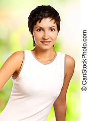 Smiling fitness woman. Isolated over green background