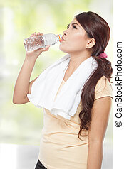 smiling fitness woman with water