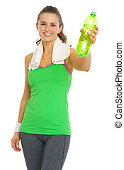 Smiling fitness young woman giving bottle of water