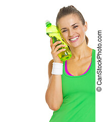 Smiling fitness young woman with bottle of water