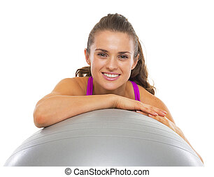 Smiling fitness young woman with fitness ball