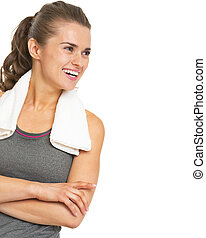 Smiling fitness young woman with towel looking on copy space