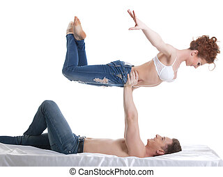 Smiling flexible lovers looking at each other