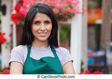 Smiling florist in garden centre - Portrait of smiling...