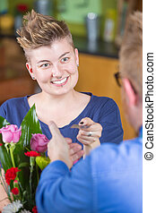Smiling Flower Shop Customer Paying with Credit