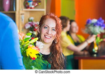 Smiling Flower Shop Owner