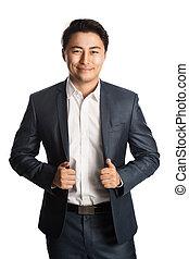 Smiling focused businessman in studio