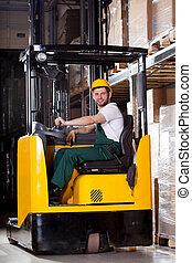 Smiling forklift driver