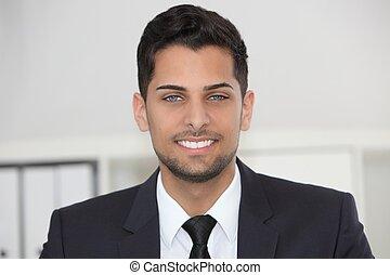 Smiling friendly businessman
