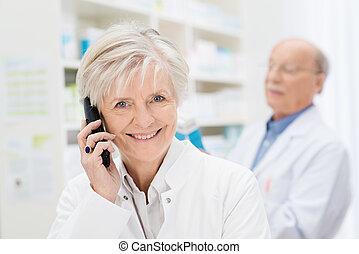 Smiling friendly female pharmacist