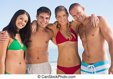 Smiling friends posing together