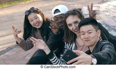 Smiling friends taking a picture - Happy multiethnic friends...