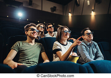 Smiling friends watching 3d movie in cinema