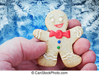 smiling gingerbread man in the hand
