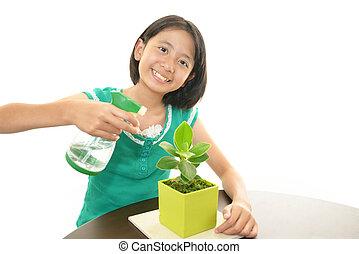 Smiling girl a foliage plant