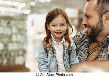 Smiling girl admiring free time with dad