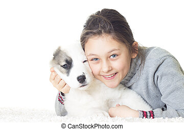 smiling girl and puppy