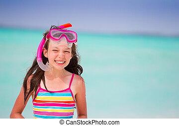 Smiling girl at beach