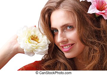 Beautiful young woman with flowers.