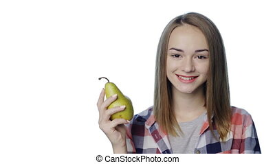 Smiling girl biting big green pear apple - Closeup of ...