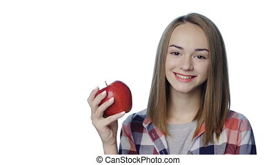 Smiling girl biting big green pear apple
