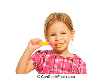 Smiling girl brush teeth