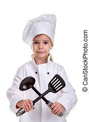 Smiling girl chef white uniform isolated on white background. Holding black ladle and scapula crossed. Portrait image