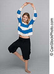 Smiling girl does fitness exercises