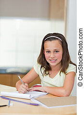 Smiling girl doing homework