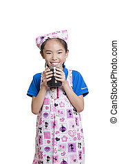 Smiling girl dressed as a cook